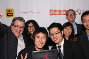 FiscalNote co-founders: Front left, Jonathan Chen, CTO; front right, Tim Hwang, CEO; and Gerald Yao, CSO in the photo booth with some lovable, sketchy characters at the first 50 on Fire.