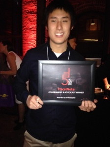 Jonathan Chen, CTO, FiscalNote holds his team's 50 on Fire award at In the Capital's 2013 event